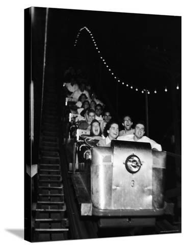 Teenagers in Rollercoaster at Night-Gordon Parks-Stretched Canvas Print