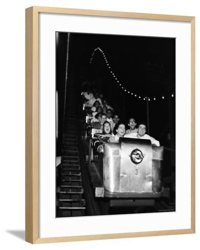 Teenagers in Rollercoaster at Night-Gordon Parks-Framed Art Print