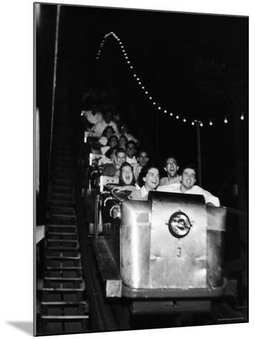 Teenagers in Rollercoaster at Night-Gordon Parks-Mounted Photographic Print