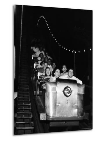 Teenagers in Rollercoaster at Night-Gordon Parks-Metal Print