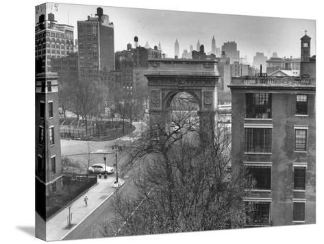 Washington Arch Standing at North Entrance to Square and Straddles Foot of Fifth Avenue-Walter Sanders-Stretched Canvas Print