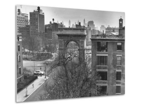 Washington Arch Standing at North Entrance to Square and Straddles Foot of Fifth Avenue-Walter Sanders-Metal Print