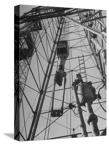 View Looking Up Derrick During Oil Drilling Operations Off Louisiana Coast-Margaret Bourke-White-Stretched Canvas Print