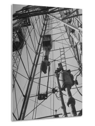 View Looking Up Derrick During Oil Drilling Operations Off Louisiana Coast-Margaret Bourke-White-Metal Print
