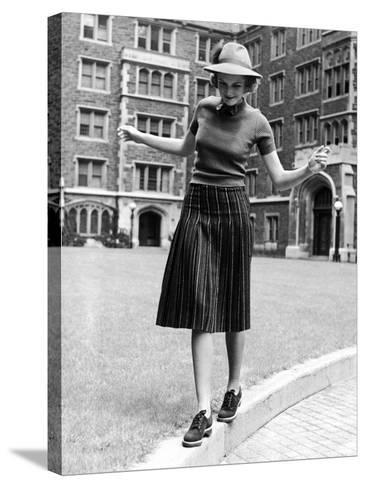 Model in Hat, Sweater and Skirt, Appearing to Balance on Curb, c.1938-Alfred Eisenstaedt-Stretched Canvas Print