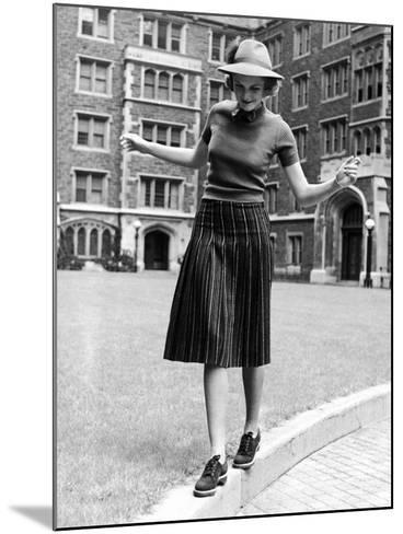 Model in Hat, Sweater and Skirt, Appearing to Balance on Curb, c.1938-Alfred Eisenstaedt-Mounted Photographic Print