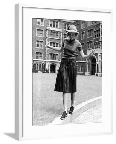 Model in Hat, Sweater and Skirt, Appearing to Balance on Curb, c.1938-Alfred Eisenstaedt-Framed Art Print