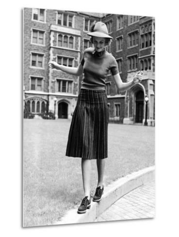Model in Hat, Sweater and Skirt, Appearing to Balance on Curb, c.1938-Alfred Eisenstaedt-Metal Print