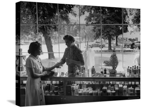 Woman Shopping For Cosmetics-Alfred Eisenstaedt-Stretched Canvas Print