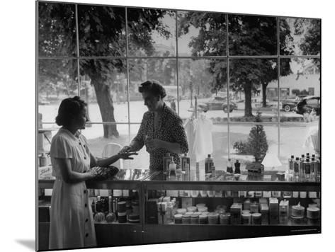 Woman Shopping For Cosmetics-Alfred Eisenstaedt-Mounted Photographic Print