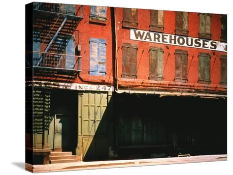 Shuttered Warehouse on the Lower East Side Lit by Late Day Sunlight-Walker Evans-Stretched Canvas Print
