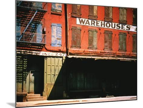 Shuttered Warehouse on the Lower East Side Lit by Late Day Sunlight-Walker Evans-Mounted Photographic Print