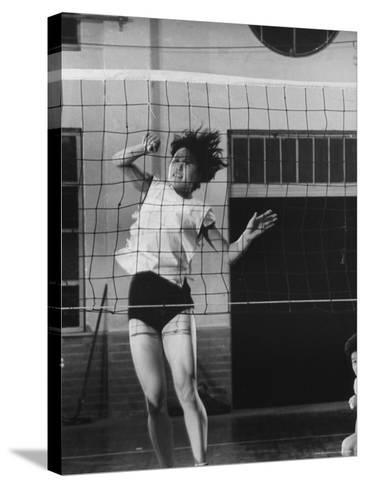Member of Japan's Nichibo Championship Women's Volleyball Team-Larry Burrows-Stretched Canvas Print