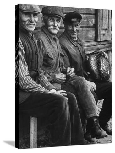 Old Men Smiling, Sitting on Bench, After Waiting in Line For Meat-Paul Schutzer-Stretched Canvas Print