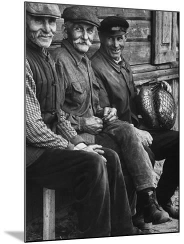 Old Men Smiling, Sitting on Bench, After Waiting in Line For Meat-Paul Schutzer-Mounted Photographic Print