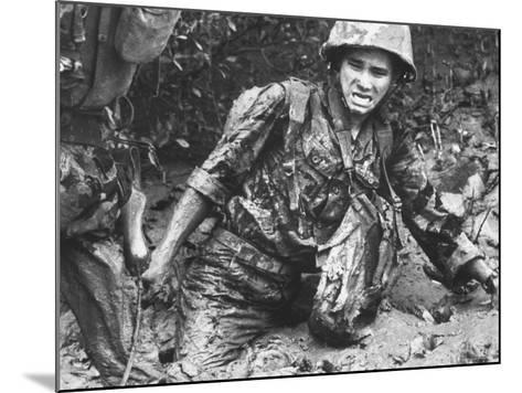Marine Sinking Into Mud-Larry Burrows-Mounted Photographic Print