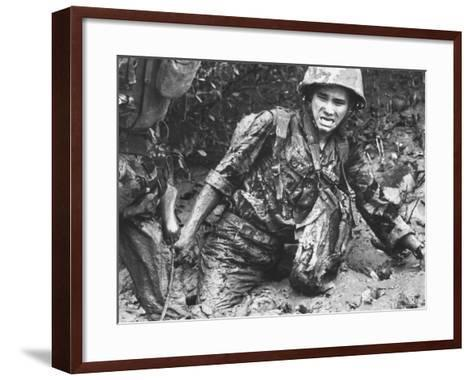 Marine Sinking Into Mud-Larry Burrows-Framed Art Print