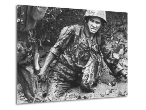 Marine Sinking Into Mud-Larry Burrows-Metal Print