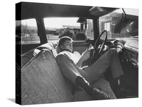 Teenager Robert Riesenmy Jr. Reading in Car at Home-Robert W^ Kelley-Stretched Canvas Print
