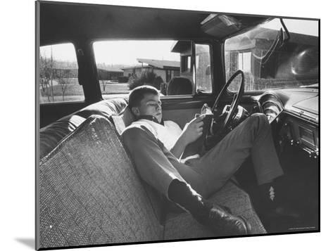 Teenager Robert Riesenmy Jr. Reading in Car at Home-Robert W^ Kelley-Mounted Photographic Print