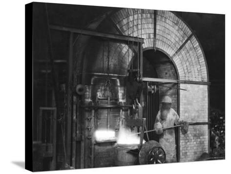 Siemens and Schukert Brass Foundry, Where Worker Has His Face Covered to Protect Against Fumes-Emil Otto Hopp?-Stretched Canvas Print