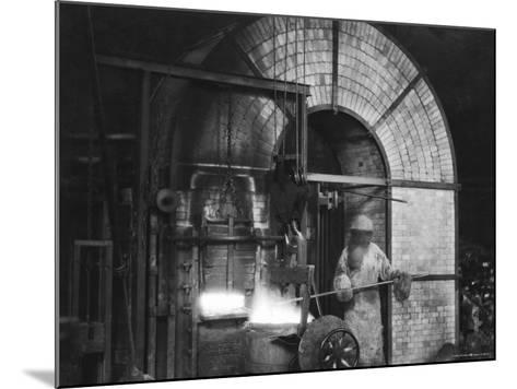 Siemens and Schukert Brass Foundry, Where Worker Has His Face Covered to Protect Against Fumes-Emil Otto Hopp?-Mounted Photographic Print