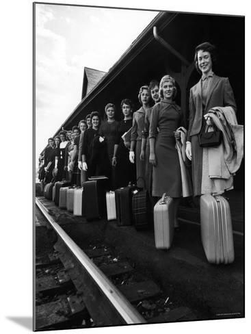 Smith College Girls Standing at Northampton Station with Their Suitcases-Yale Joel-Mounted Photographic Print
