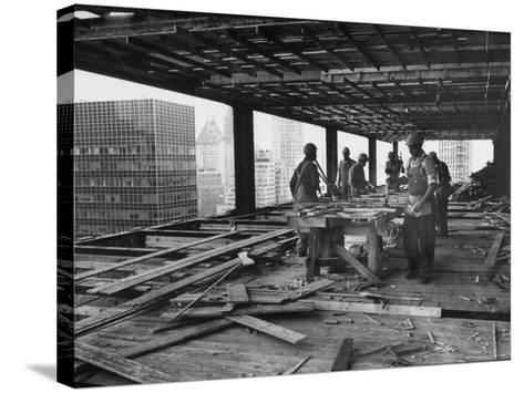 Workers During Construction of Seagrams Building-Frank Scherschel-Stretched Canvas Print