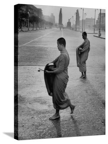 Monks Begging For Food at Dawn on Main Thoroughfare of Bangkok-Howard Sochurek-Stretched Canvas Print