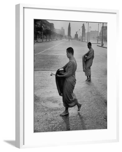 Monks Begging For Food at Dawn on Main Thoroughfare of Bangkok-Howard Sochurek-Framed Art Print