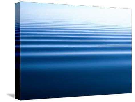 Small Gentle Ripples Move Across the Calm Surface of the Arctic Ocean-Norbert Rosing-Stretched Canvas Print