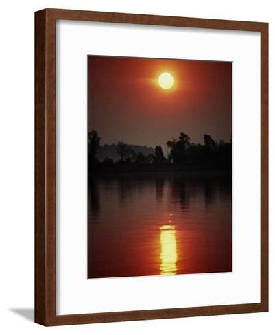 A Fiery Sun Rises Above the Tree-Lined Shore of the Wye River-Stephen St^ John-Framed Art Print