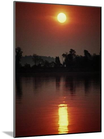 A Fiery Sun Rises Above the Tree-Lined Shore of the Wye River-Stephen St^ John-Mounted Photographic Print
