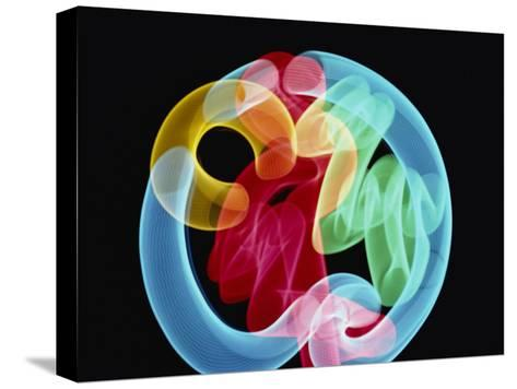 Soft Focus Distorts a Neon Flamingo in a Blue Circle-Stephen St^ John-Stretched Canvas Print
