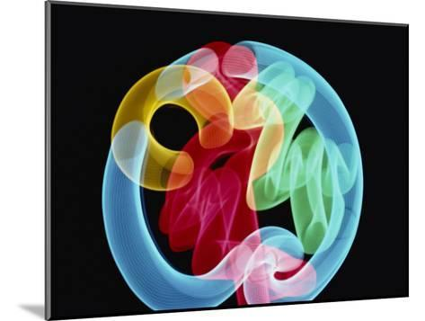 Soft Focus Distorts a Neon Flamingo in a Blue Circle-Stephen St^ John-Mounted Photographic Print