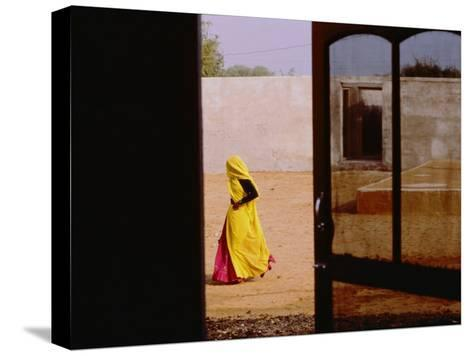 A Person Walking Past an Open Doorway-Michael S^ Lewis-Stretched Canvas Print