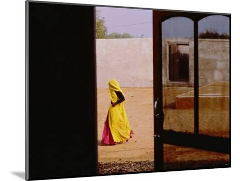 A Person Walking Past an Open Doorway-Michael S^ Lewis-Mounted Photographic Print