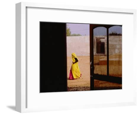 A Person Walking Past an Open Doorway-Michael S^ Lewis-Framed Art Print
