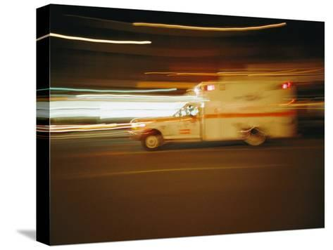 An Ambulance Rushes Past at Night-Stephen St^ John-Stretched Canvas Print
