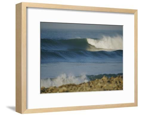 Large Waves Break and Rush to a Rocky Shore at Sunrise-Rich Reid-Framed Art Print