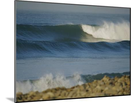Large Waves Break and Rush to a Rocky Shore at Sunrise-Rich Reid-Mounted Photographic Print