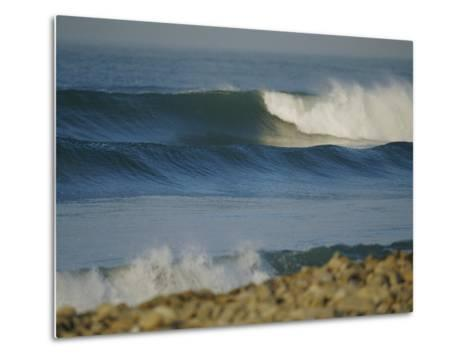 Large Waves Break and Rush to a Rocky Shore at Sunrise-Rich Reid-Metal Print