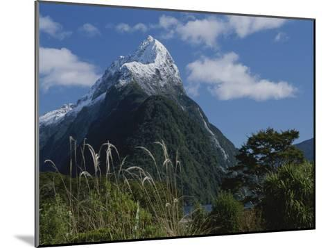 Mitre Peak in Milford Sound with Puffy White Clouds-Todd Gipstein-Mounted Photographic Print