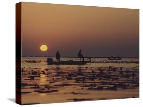 Fishermen Take in the First Rays of the Rising Sun on Lake Okeechobee-Nicole Duplaix-Stretched Canvas Print