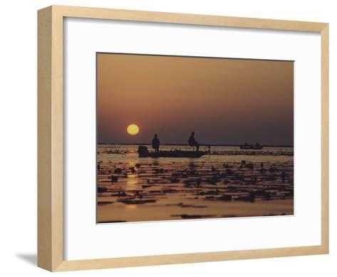 Fishermen Take in the First Rays of the Rising Sun on Lake Okeechobee-Nicole Duplaix-Framed Art Print