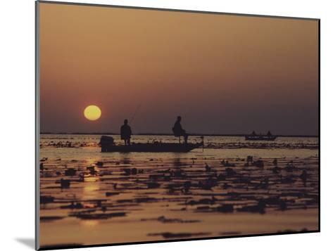 Fishermen Take in the First Rays of the Rising Sun on Lake Okeechobee-Nicole Duplaix-Mounted Photographic Print