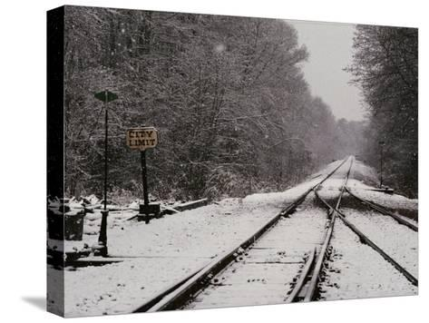 Railroad Tracks in Snow at the Courtland City Limit-Medford Taylor-Stretched Canvas Print