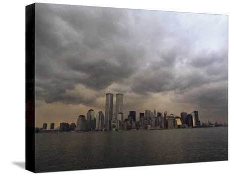Storm Clouds over Lower Manhattan from the New Jersey Shore-Medford Taylor-Stretched Canvas Print