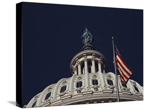 An American Flag and the Statue of Freedom Atop the Capitol Dome-Medford Taylor-Stretched Canvas Print