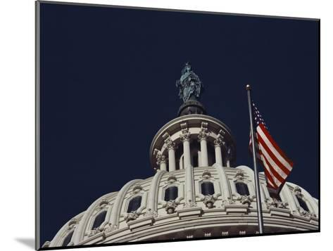 An American Flag and the Statue of Freedom Atop the Capitol Dome-Medford Taylor-Mounted Photographic Print